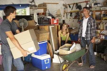 family clearing garage from household junk