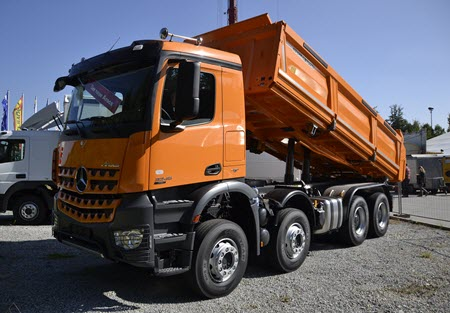 Large Orange dumpster rental truck