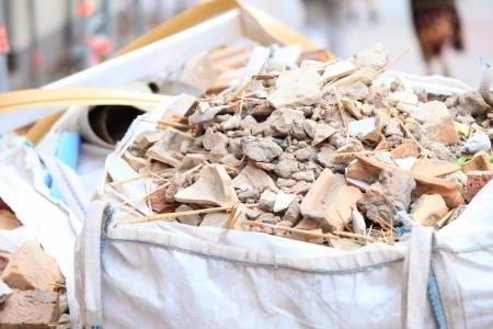 Construction waste debris bags full of bricks and demolition debris